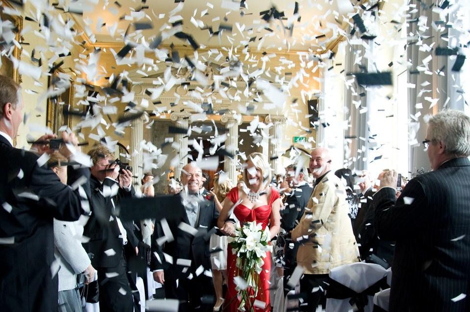alternative-confetti-ideas-married-couple-showered-in-black-and-white-confetti.jpg