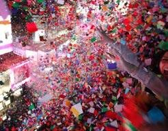 Multicoloured loose confetti showering a crowd